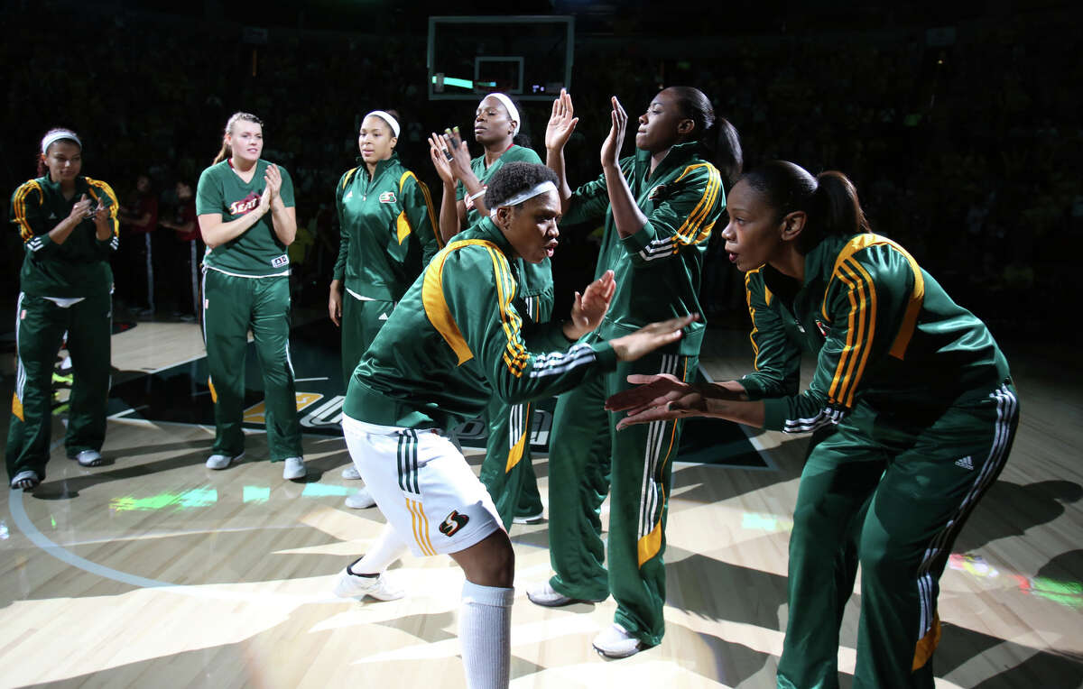Seattle Storm player Tanisha Wright takes the court against the Phoenix Mercury during the Seattle Storm home opener on Sunday, June 2, 2013 at KeyArena in Seattle.