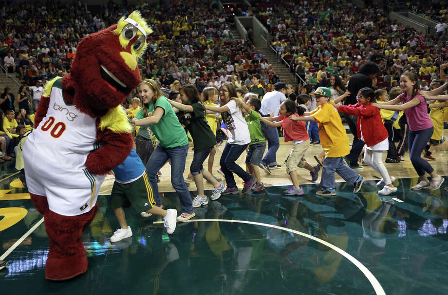 Seattle Storm mascot Doppler leads young fans during the Seattle Storm home opener against the Phoenix Mercury on Sunday, June 2, 2013 at KeyArena in Seattle. Photo: JOSHUA TRUJILLO, SEATTLEPI.COM / SEATTLEPI.COM