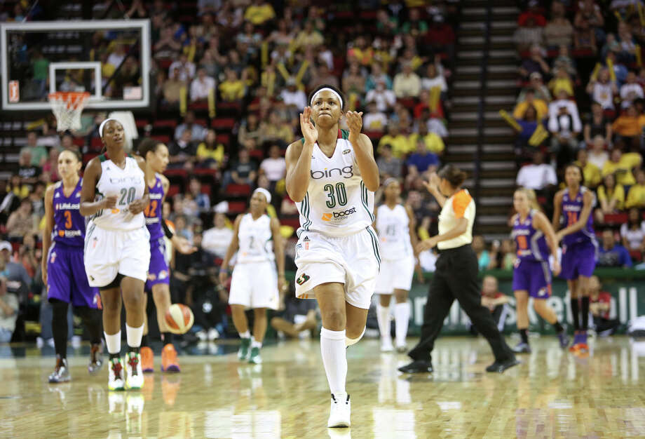 Seattle Storm player Tanisha Wright applauds after Phoenix Mercury player Brittney Griner was called for a foul during the Seattle Storm home opener on Sunday, June 2, 2013 at KeyArena in Seattle. Photo: JOSHUA TRUJILLO, SEATTLEPI.COM / SEATTLEPI.COM