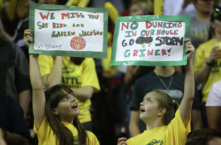 Young Seattle Storm fans hold up signs during the Seattle Storm home opener against the Phoenix Mercury on Sunday, June 2, 2013 at KeyArena in Seattle. Photo: JOSHUA TRUJILLO, SEATTLEPI.COM / SEATTLEPI.COM