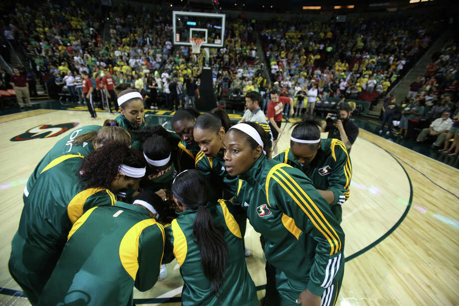 Seattle Storm players take to the court against the Phoenix Mercury during the Seattle Storm home opener on Sunday, June 2, 2013 at KeyArena in Seattle. Photo: JOSHUA TRUJILLO, SEATTLEPI.COM / SEATTLEPI.COM