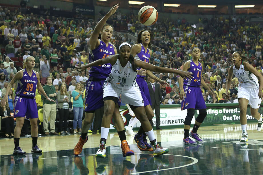 Seattle Storm player Camille Little tries to keep the ball from Phoenix Mercury player Brittney Griner and DeWanna Bonner during the Seattle Storm home opener on Sunday, June 2, 2013 at KeyArena in Seattle. Photo: JOSHUA TRUJILLO, SEATTLEPI.COM / SEATTLEPI.COM
