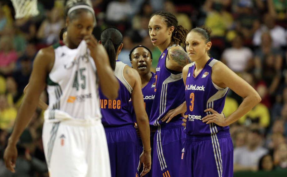 Phoenix Mercury player Brittney Griner, center, reacts after a foul against the Seattle Storm during the home opener on Sunday, June 2, 2013 at KeyArena in Seattle. Photo: JOSHUA TRUJILLO, SEATTLEPI.COM / SEATTLEPI.COM