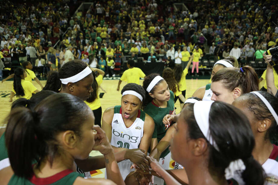 Seattle Storm players gather at center court after defeating the Phoenix Mercury during the Seattle Storm home opener on Sunday, June 2, 2013 at KeyArena in Seattle. Photo: JOSHUA TRUJILLO, SEATTLEPI.COM / SEATTLEPI.COM