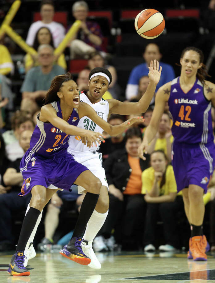 Seattle Storm player Tanisha Wright tries to take control of the ball from Phoenix Mercury player DeWanna Bonner during the Seattle Storm home opener on Sunday, June 2, 2013 at KeyArena in Seattle. Photo: JOSHUA TRUJILLO, SEATTLEPI.COM / SEATTLEPI.COM