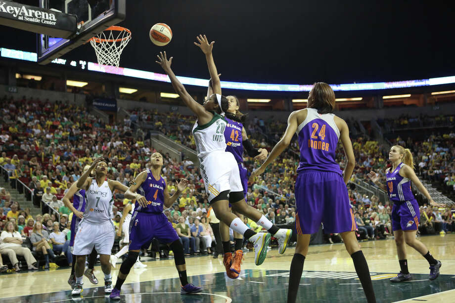 Seattle Storm player Camille Little goes to the hoop against the Phoenix Mercury player Brittney Griner (42) during the Seattle Storm home opener on Sunday, June 2, 2013 at KeyArena in Seattle. Photo: JOSHUA TRUJILLO, SEATTLEPI.COM / SEATTLEPI.COM