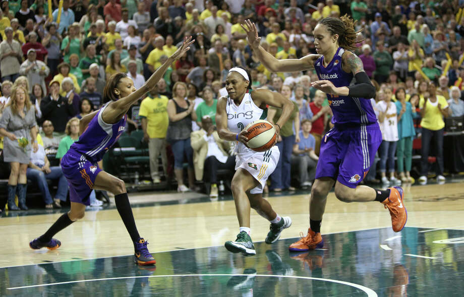 Seattle Storm player Temeka Johnson goes to the hoop against the Phoenix Mercury players DeWanna Bonner and Brittney Griner during the Seattle Storm home opener on Sunday, June 2, 2013 at KeyArena in Seattle. Photo: JOSHUA TRUJILLO, SEATTLEPI.COM / SEATTLEPI.COM