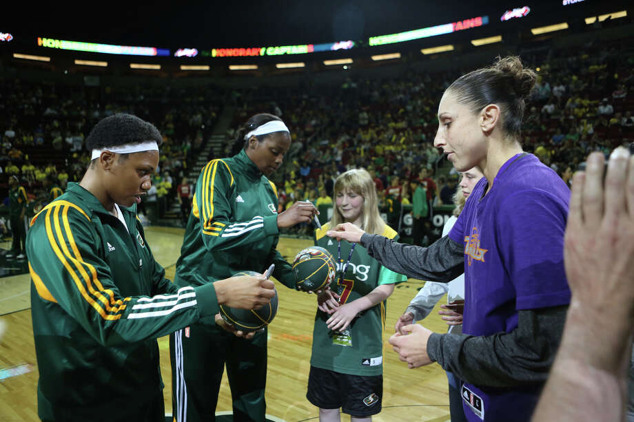 Seattle Storm players sign autographs at center court  before a game against the Phoenix Mercury on Sunday, June 2, 2013 at KeyArena in Seattle. Photo: JOSHUA TRUJILLO, SEATTLEPI.COM / SEATTLEPI.COM