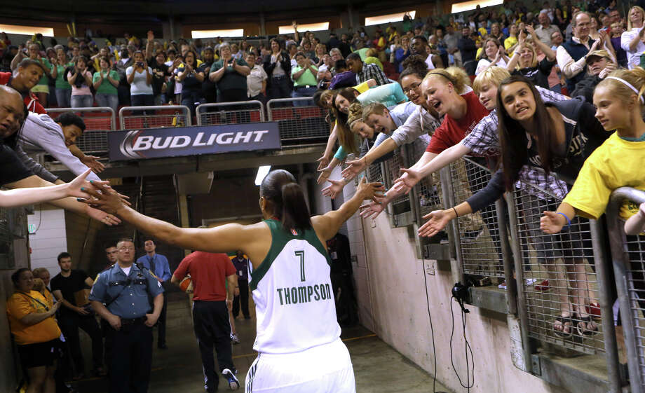 Seattle Storm player Tina Thompson runs off the court after defeating the Phoenix Mercury during the Seattle Storm home opener on Sunday, June 2, 2013 at KeyArena in Seattle. Photo: JOSHUA TRUJILLO, SEATTLEPI.COM / SEATTLEPI.COM