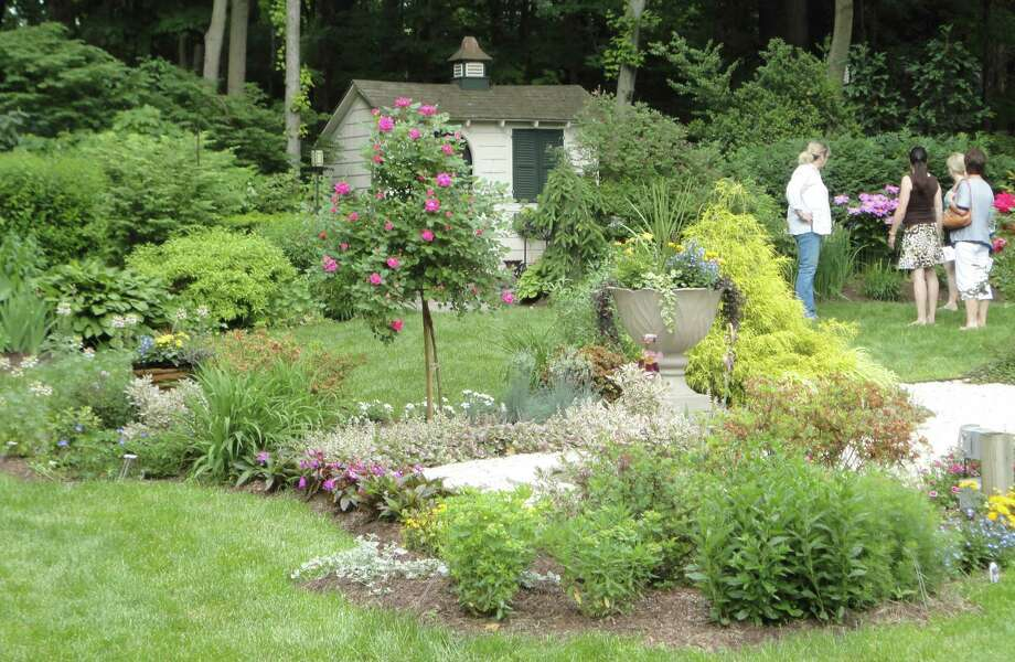 Visitors to the Liistro property on Meadowbrook Lane in Westport admire the upper gardens during Sunday's Hidden Gardens Tour sponsored by the Westport Historical Society. Photo: Meg Barone / Westport News contributed