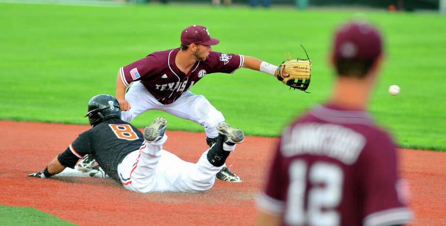 Texas A&M 's Mikey Reynolds (16) waits for the ball as Oregon State's Michael Conforto (8) slides into second during the second inning of an NCAA college regional tournament baseball game in Corvallis, Ore., Sunday, June 2, 2013. (AP Photo/Greg Wahl-Stephens) Photo: Greg Wahl-Stephens, Associated Press / FR29287 AP