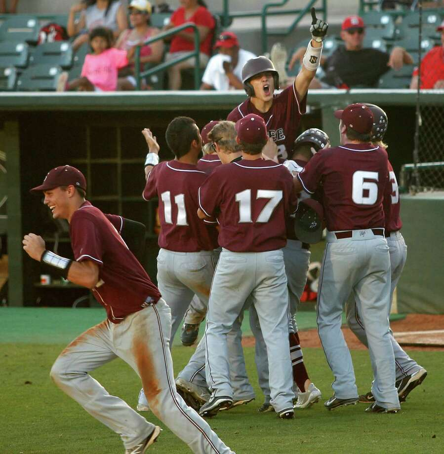 Colby Leblanc (top) is mobbed by teammates after scoring the winning run during the seventh inning of Game 3 of the 3A Regional Final against Diboll, Saturday, June 1, 2013 at Reckling Park in Houston, TX. (Photo: Eric Christian Smith/For the Enterprise) Photo: Eric Christian Smith, Freelance