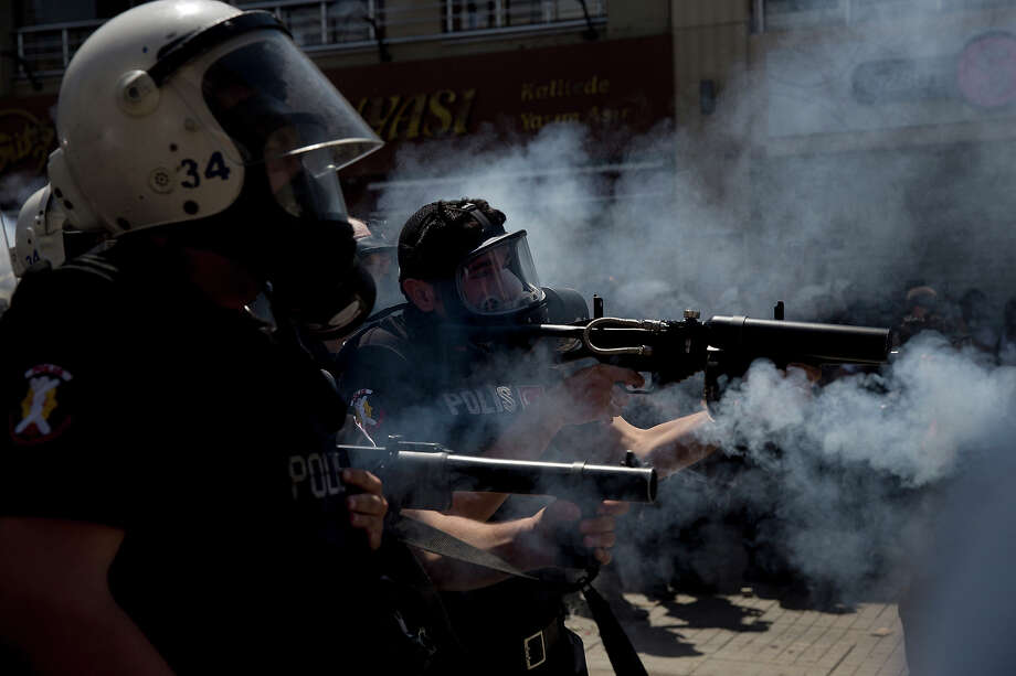 Turkish police fire tear gas during a clash with protesters in Taksim Square in Istanbul, Turkey on June 1, 2013. What started out as a protest over the demolition of a park in Istanbul has revealed pent up popular frustrations against Prime Minister Recep Tayyip Erdogan who many Turks view as slowly taking away the rights of its citizens. Photo: Ed Ou / 2013 Ed Ou
