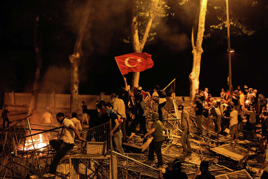 Protestors clash with police between Taksim and Besiktas in Istanbul, on June 1, during a demonstration against the demolition of the park. Turkish police on June 1 began pulling out of Istanbul's iconic Taksim Square, after a second day of violent clashes between protesters and police over a controversial development project. Thousands of demonstrators flooded the site as police lifted the barricades around the park and began withdrawing from the square. What started as an outcry against a local development project has snowballed into widespread anger against what critics say is the government's increasingly conservative and authoritarian agenda. Photo: AFP, AFP/Getty Images / 2013 AFP