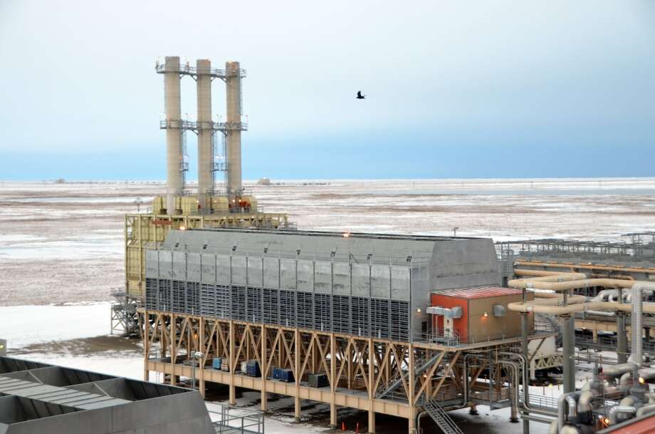 A bird flies above one portion of the central gas facility on BP's Prudhoe Bay Oil Field in Alaska. After separating out oil and water, natural gas is sent to the central gas facility for further processing. There, natural gas liquids are extracted, allowing them to be fed into the Trans-Alaska Pipeline System. Photo: Jennifer A. Dlouhy, Houston Chronicle