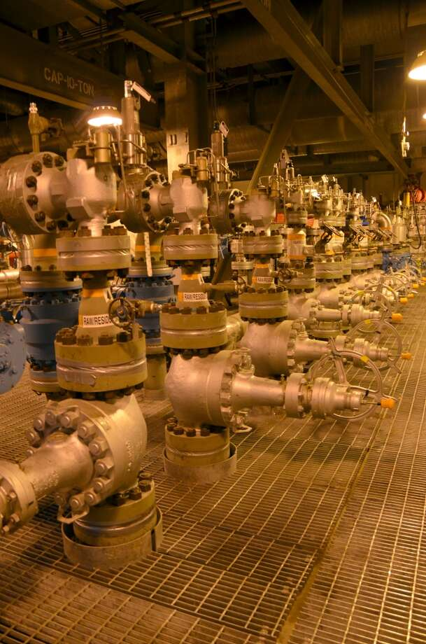 A parade of pumps and valves line a small section of the massive central gas facility at BP's Prudhoe Bay Oil Field in Alaska. Part of the North Slope, Prudhoe Bay is the largest oil field in North America. It is operated by BP; the main partners are Exxon Mobil and ConocoPhillips. Photo: Jennifer A. Dlouhy, Houston Chronicle