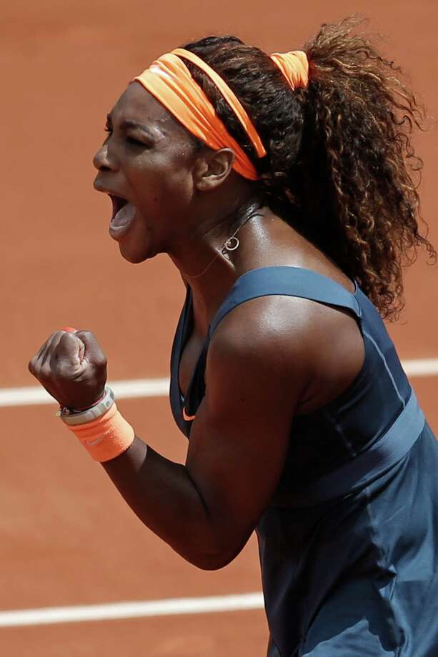 Serena Williams of the U.S. clenches her fist after scoring against Italy's Roberta Vinci in their fourth round match at the French Open tennis tournament, at Roland Garros stadium in Paris, Sunday June 2, 2013. Williams won in two sets 6-1, 6-3. Photo: Christophe Ena, AP / AP