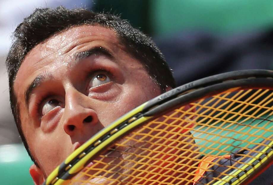 Spain's Nicolas Almagro eyes the ball as he returns against compatriot Tommy Robredo in their fourth round match at the French Open tennis tournament, at Roland Garros stadium in Paris, Sunday June 2, 2013. Photo: Michel Euler, AP / AP