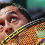 Spain's Nicolas Almagro eyes the ball as he returns against compatriot Tommy Robredo in their fourth round match at the French Open tennis tournament, at Roland Garros stadium in Paris, Sunday June 2, 2013.