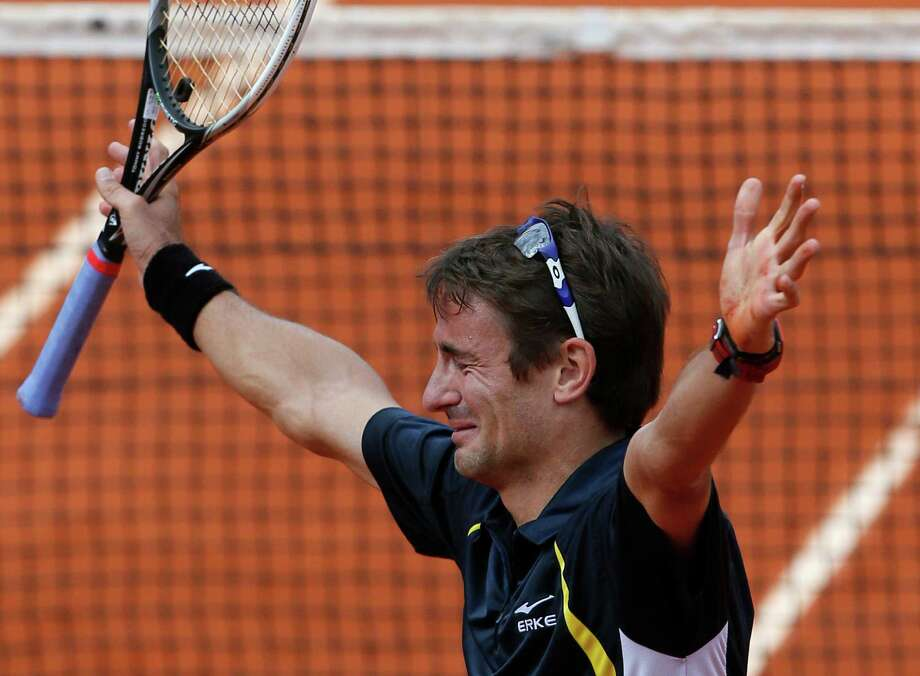 Spain's Tommy Robredo cries after defeating compatriot Nicolas Almagro during their fourth round match of the French Open tennis tournament at the Roland Garros stadium Sunday, June 2, 2013 in Paris. Photo: Michel Spingler, AP / AP
