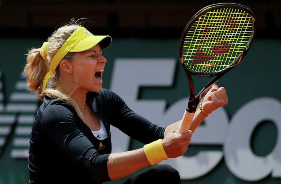 Russia's Maria Kirilenko celebrates defeating Bethanie Mattek-Sands of the U.S. in two sets 7-5, 6-4, in their fourth round match at the French Open tennis tournament, at Roland Garros stadium in Paris, Monday June 3, 2013. Photo: Petr David Josek, AP / AP