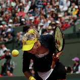 Russia's Maria Kirilenko reacts after a winning point as she plays USA's Bethanie Mattek-Sands during their fourth round match of the French Open tennis tournament at the Roland Garros stadium Monday, June 3, 2013 in Paris.