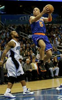 New York Knicks' Jason Kidd (5) takes a shot next to Orlando Magic's Jameer Nelson (14) during the first half of an NBA basketball game, Saturday, Jan. 5, 2013, in Orlando, Fla. (AP Photo/John Raoux) Photo: John Raoux, Associated Press / AP