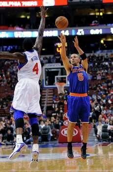 New York Knicks' Jason Kidd (5) shoots over Philadelphia 76ers' Dorell Wright (4) during an NBA basketball game on Monday, Nov. 5, 2012, in Philadelphia. The Knicks won 110-88. (AP Photo/Michael Perez) Photo: Michael Perez, Associated Press / FR168006 AP
