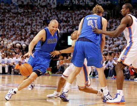 Dallas Mavericks point guard Jason Kidd (2) drives past a pick set by teammate Dallas Mavericks power forward Dirk Nowitzki (41) as Oklahoma City Thunder point guard Derek Fisher (37) is stopped during the first half of Game 2 of the NBA Western Conference Quarterfinals at the Chesapeake Energy Arena in Oklahoma City, Oklahoma, Monday, April 30, 2012. (Vernon Bryant/Dallas Morning News/MCT) Photo: Vernon Bryant, McClatchy-Tribune News Service / Dallas Morning News