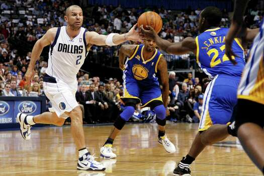 Dallas Mavericks' Jason Kidd (2) and Golden State Warriors' Charles Jenkins (22) reach out for a loose ball as Dorell Wright (1) watches in the first half of an NBA basketball game Friday, April 20, 2012, in Dallas. Photo: Tony Gutierrez, Associated Press / AP