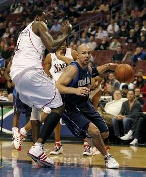 Dallas Mavericks' Jason Kidd,right, drives against Philadelphia 76ers' Samuel Dalembert in the first period of an NBA basketball game Monday, Jan. 19, 2009, in Philadelphia. Photo: H. Rumph, Jr., AP / FR61717 AP