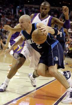 Dallas Mavericks guard Jason Kidd, front, drives to the basket by Phoenix Suns guard Leandro Barbosa, rear, of Brazil, in the first quarter of an NBA basketball game Sunday, April 6, 2008, in Phoenix. Photo: Paul Connors, AP / AP