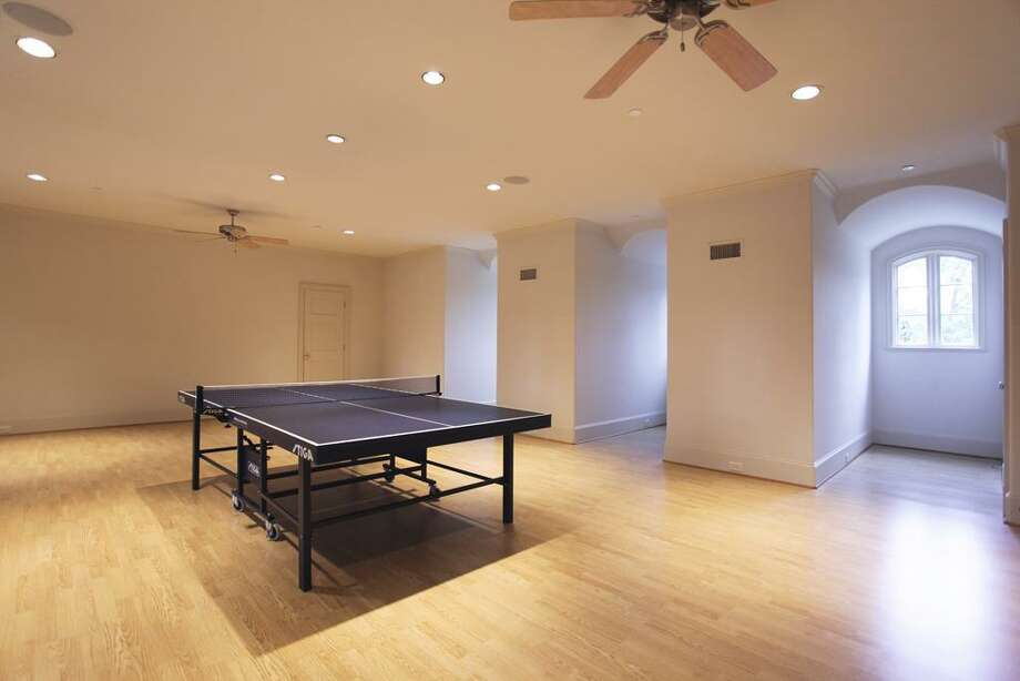 On the third floor, you will discover an enormous game room suitable for any need with three dormers positioned on either side. Below this room is also another huge space for an exercise room which can accommodate a full array of equipment. Photo: HAR
