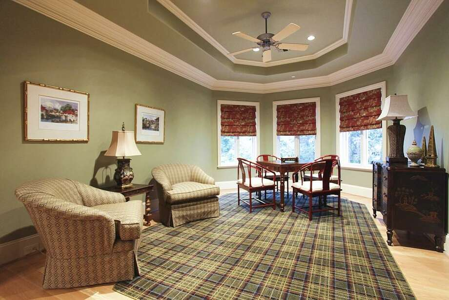 The card room is that special place for sitting, card playing and recreational social gatherings. It offers a tray ceiling, casement windows, oak floors and a custom cut rug. Photo: HAR