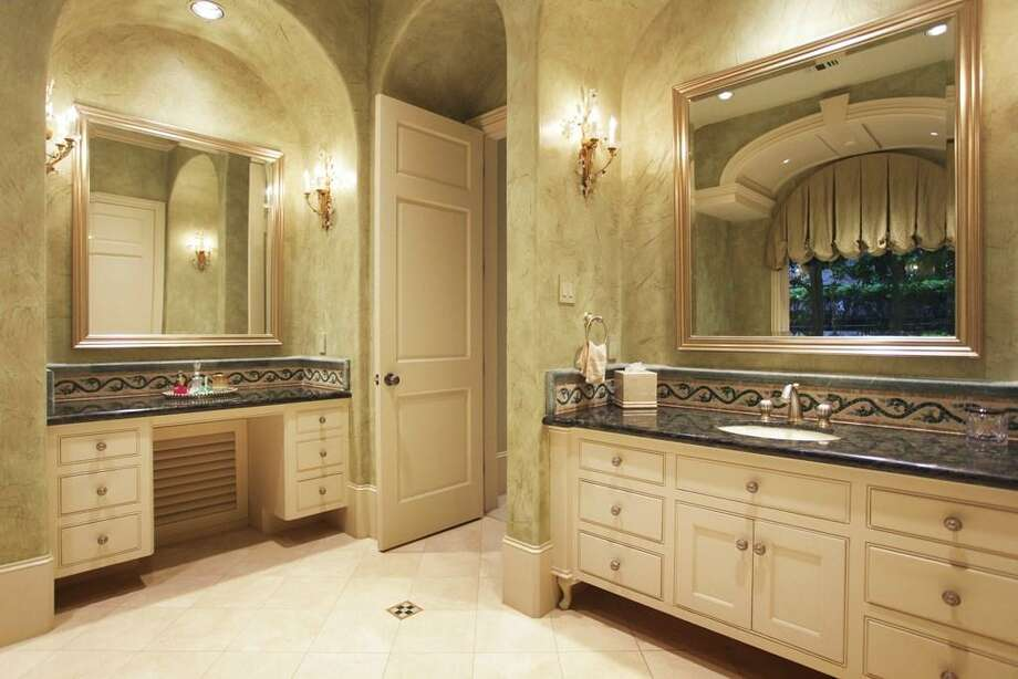 When it comes to luxury, the His & Her baths hold their own. Her side offers a separate vanity & dressing space, Kohler commode and bidet, mosaic tile backsplash, sconce and recessed lighting and marble floors. Photo: HAR