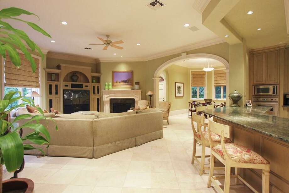 Tucked away towards the rear of the home, you will find the family room, breakfast room and kitchen which all interact as one large open space. Photo: HAR