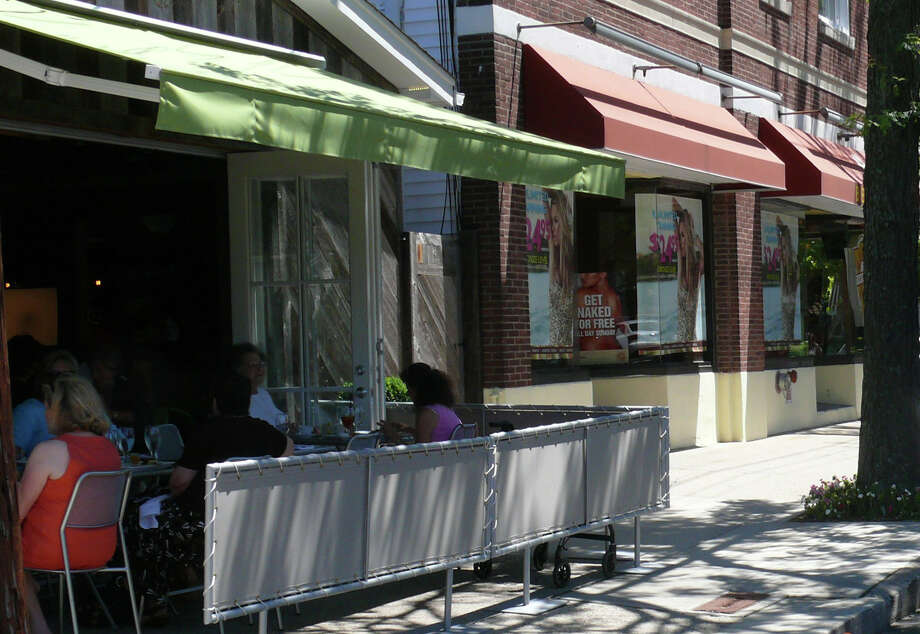 The owners of The Chelsea on Unquowa Place lost their outdoor dining when it was discovered they have yet to sign a lease with the town for the use of the sidewalk. The restaurant had been using the sidewalk since last summer. Photo: File Photo / Fairfield Citizen