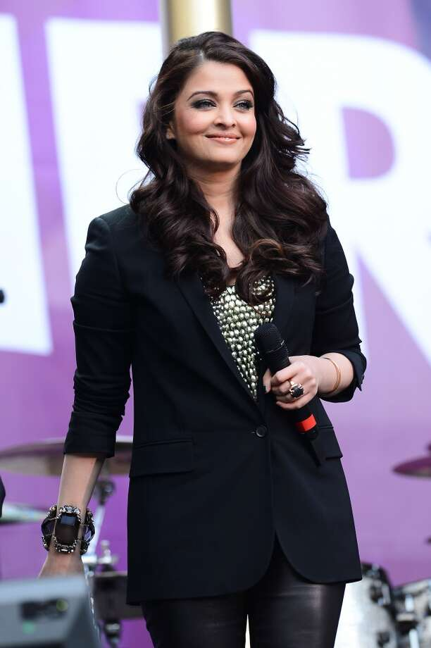 "LONDON, ENGLAND - JUNE 01:  Aishwarya Rai Bachchan speaks on stage at the ""Chime For Change: The Sound Of Change Live"" Concert at Twickenham Stadium on June 1, 2013 in London, England. Chime For Change is a global campaign for girls' and women's empowerment founded by Gucci with a founding committee comprised of Gucci Creative Director Frida Giannini, Salma Hayek Pinault and Beyonce Knowles-Carter.  (Photo by Ian Gavan/Getty Images for Gucci)"