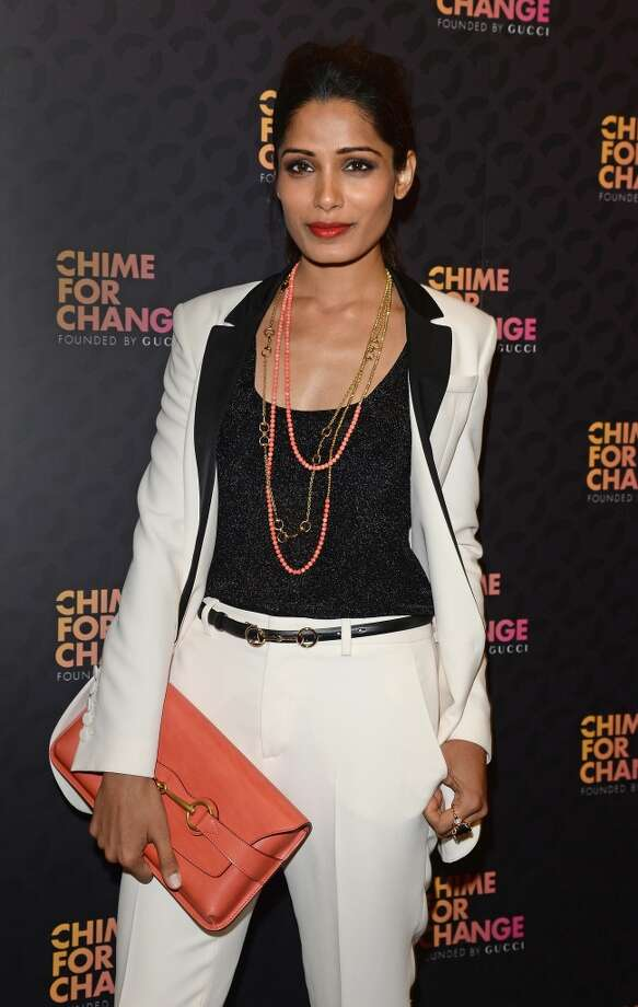 "LONDON, ENGLAND - JUNE 01:  Actress Freida Pinto arrives at the Royal Box photo wall ahead of the ""Chime For Change: The Sound Of Change Live"" Concert at Twickenham Stadium on June 1, 2013 in London, England. Chime For Change is a global campaign for girls' and women's empowerment founded by Gucci with a founding committee comprised of Gucci Creative Director Frida Giannini, Salma Hayek Pinault and Beyonce Knowles-Carter.  (Photo by Daniele Venturelli/Getty Images for Gucci)"