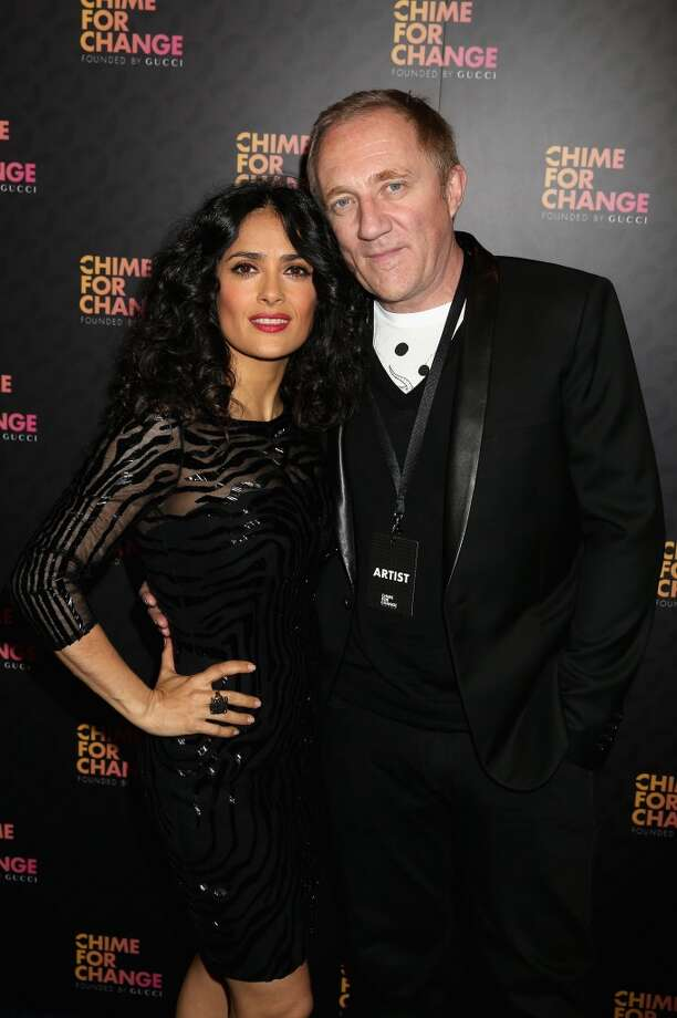"LONDON, ENGLAND - JUNE 01:  Salma Hayek Pinault and Francois Henri Pinault arrive at the Royal Box photo wall ahead of the ""Chime For Change: The Sound Of Change Live"" Concert at Twickenham Stadium on June 1, 2013 in London, England. Chime For Change is a global campaign for girls' and women's empowerment founded by Gucci with a founding committee comprised of Gucci Creative Director Frida Giannini, Salma Hayek Pinault and Beyonce Knowles-Carter.  (Photo by Chris Jackson/Getty Images for Gucci)"
