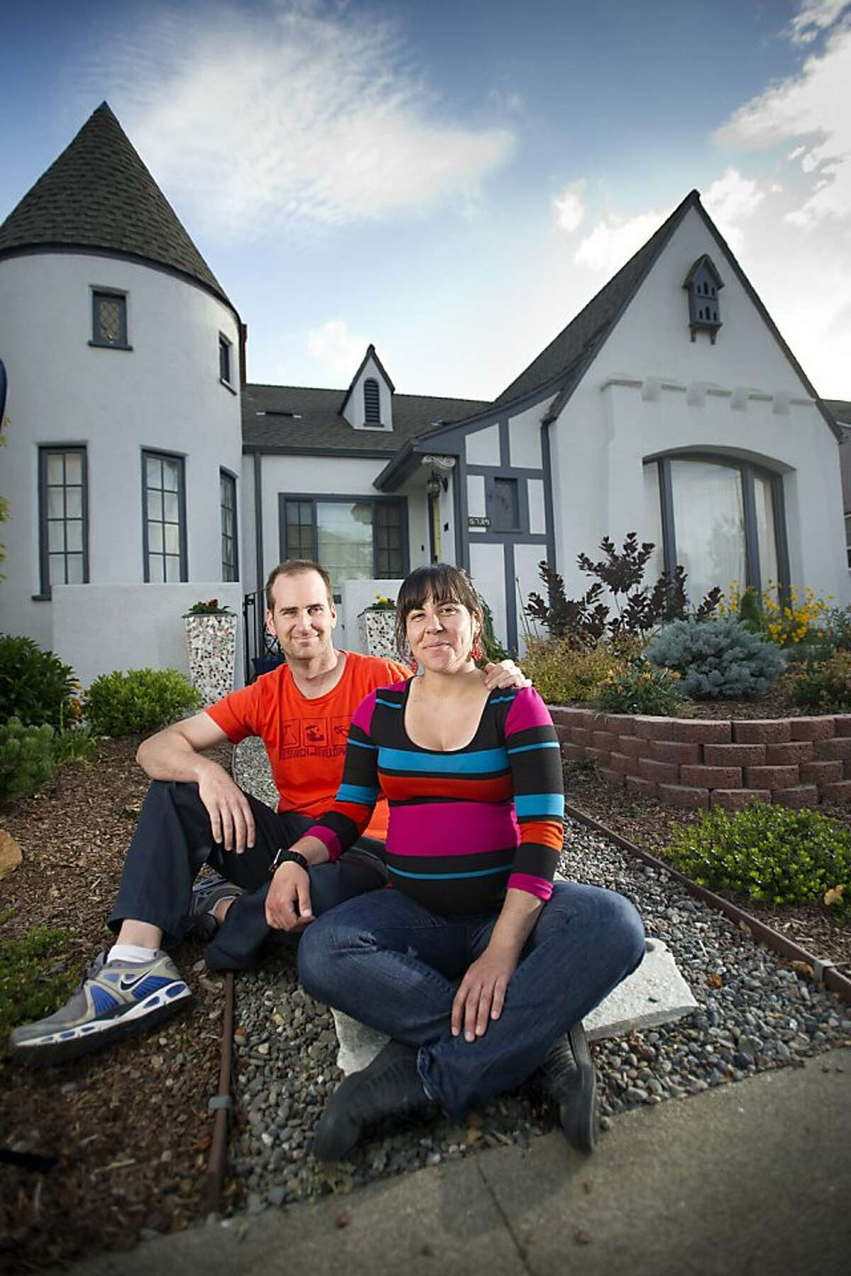 Meryl Phillips and Chris Miller sit outside their Oakland, Calif., home on Thursday, May 15, 2013. The couple recounts their do-it-yourself renovation on a blog called The Picardy Project.