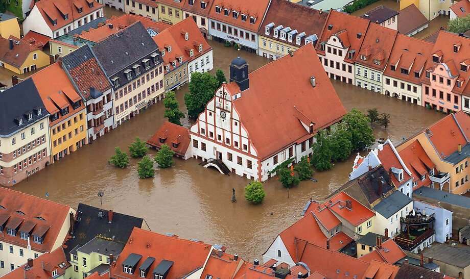 A moat forms aroundthe landmark Town Hall in Grimma, Germany, after several days of heavy rain   flooded parts of one of the most beautiful towns in Saxony. Photo: Jens Wolf, AFP/Getty Images