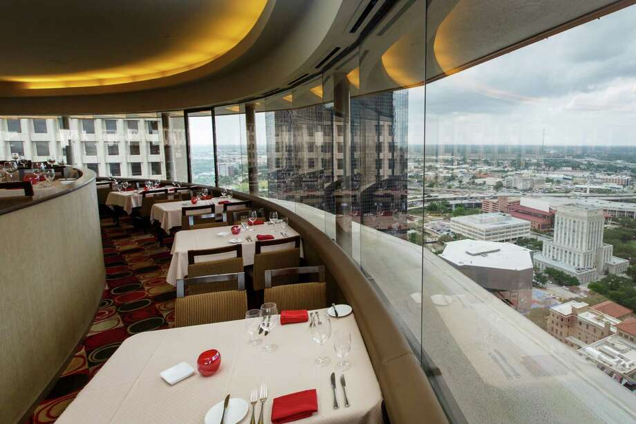 The rotating view seen at the Spindletop Restaurant at the top of the Hyatt Regency. That view earned it the title of Houston's most scenic spot on a recent OpenTable list.  Photo: Michael Paulsen, Houston Chronicle / © 2013 Houston Chronicle