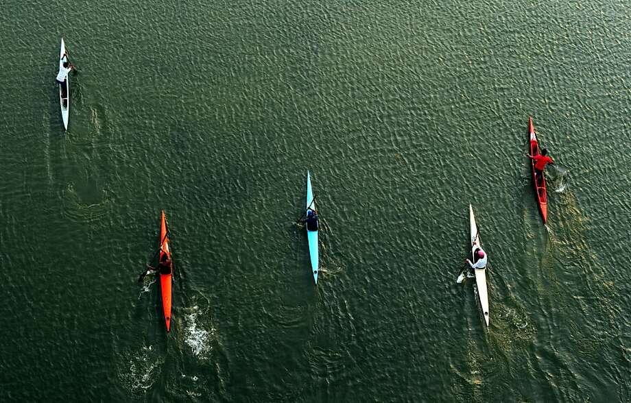 Competitive canoeistsmake a practice run on the Yamuna River in Allahabad. Photo: Sanjay Kanojia, AFP/Getty Images