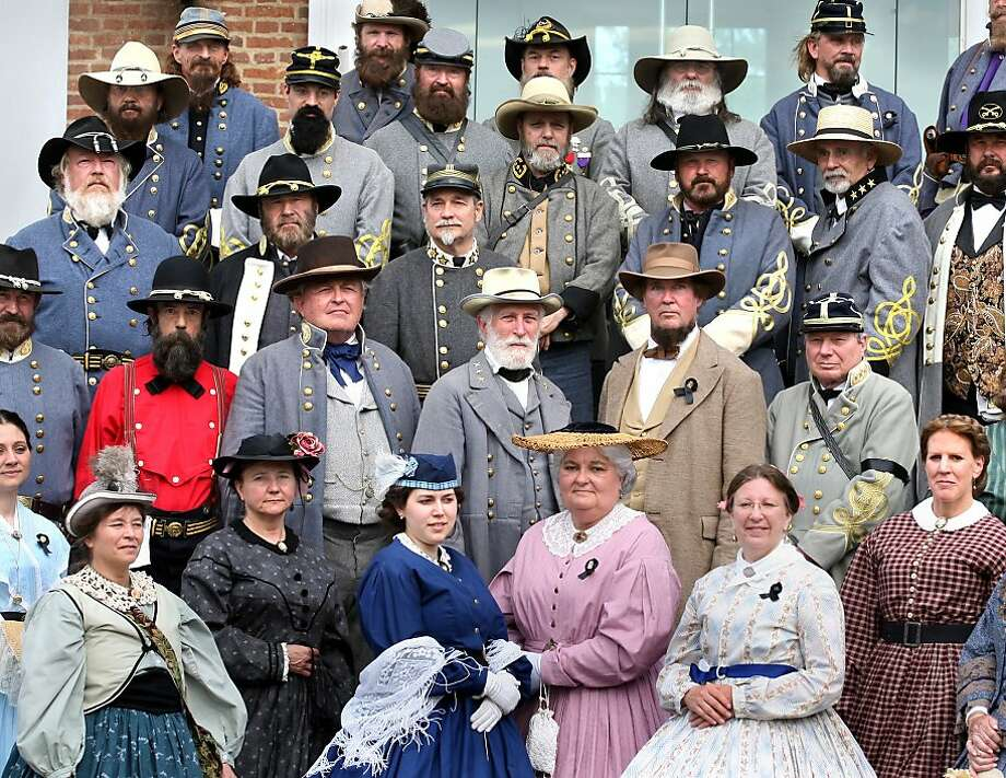 OK, who invited Grant (behind red shirt to the right)? Lee's Lieutenants, a group of Civil War buffs who enjoy impersonating Confederate generals, gathers for a photo on the steps of the 1840 Old Court House Civil War Museum in Winchester, Va. At center is Gen. Robert E. Lee (Al Stone of Hinton, W.Va.). Photo: Jeff Taylor, Associated Press