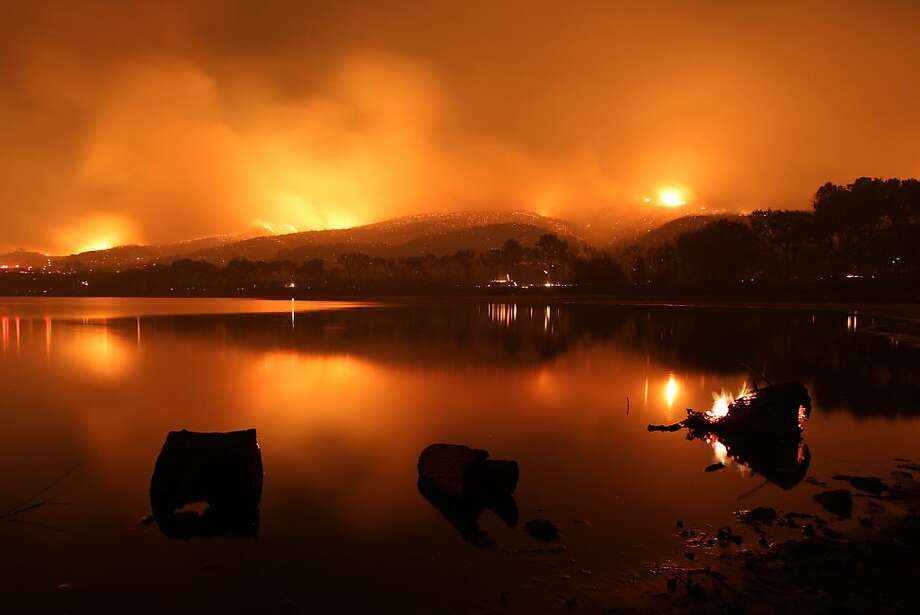 Eerie lake: The Powerhouse Fire approaches Lake Elizabeth near Lake Hughes, Calif. The blaze has burned about 46 square miles in mountain and canyon areas, destroying at least six houses and damaging 15 more. Photo: David McNew, Getty Images