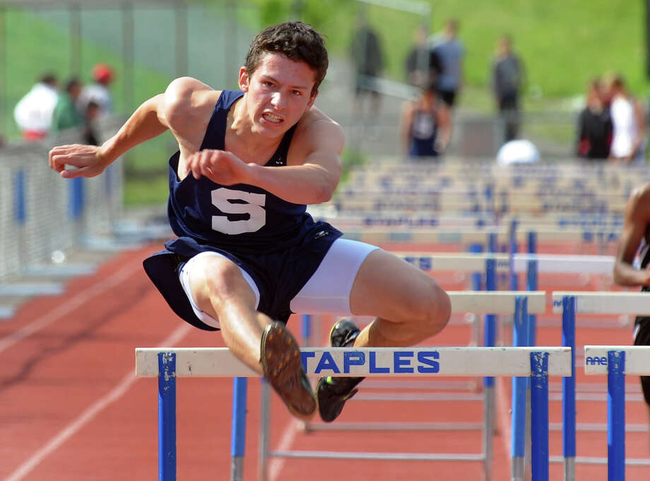 Staples Bobby Jacowleff clears the final hurdle in the 110 meter hurdles event, during track action against Fairfield Warde and New Canaan at Staples in Westport, Conn. on Tuesday May 14, 2013. Photo: Christian Abraham / Connecticut Post