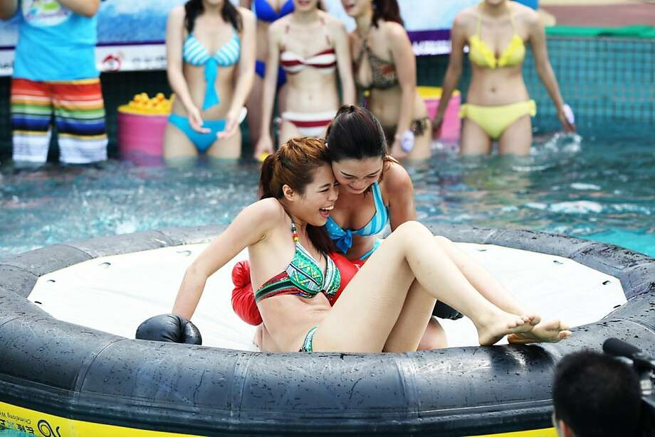 No fraternizing between rounds, ladies: Unlike other beauty contests, the Miss Bikini competition in Guangzhou, China, requires 