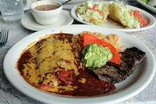 The Plato de Los Barrios at Viola's Ventanas comes with two beef tacos, two cheese enchiladas and a strip of steak served with Spanish rice, choice of refried or charro beans and guacamole. Puffy tacos (shown here) can be substituted for crispy tacos.