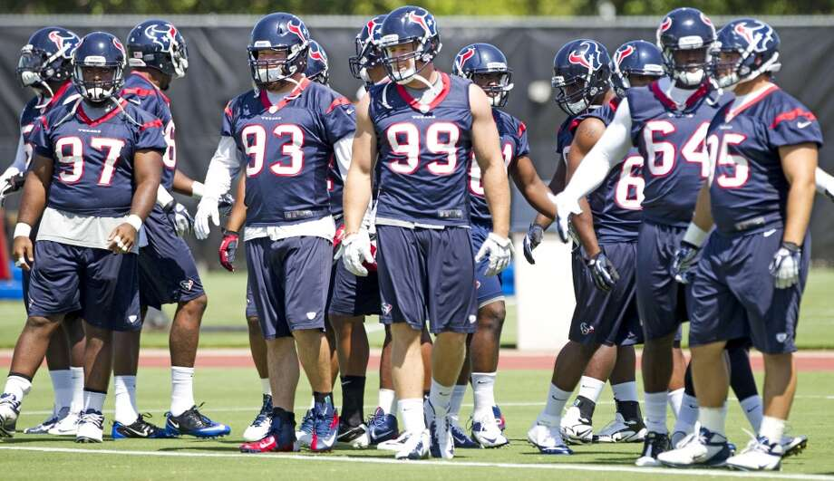 Texans players line up for warm ups during Monday's OTAs at the Methodist Training Center.